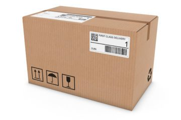 Cardboard Box with Shipping Labels Isolated on White Background
